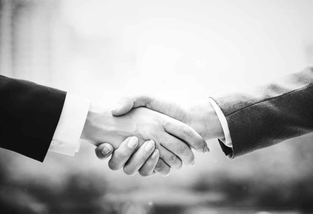two person doing hand shake