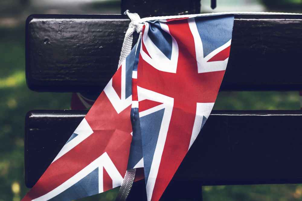united kingdom flag tied to a wooden bench