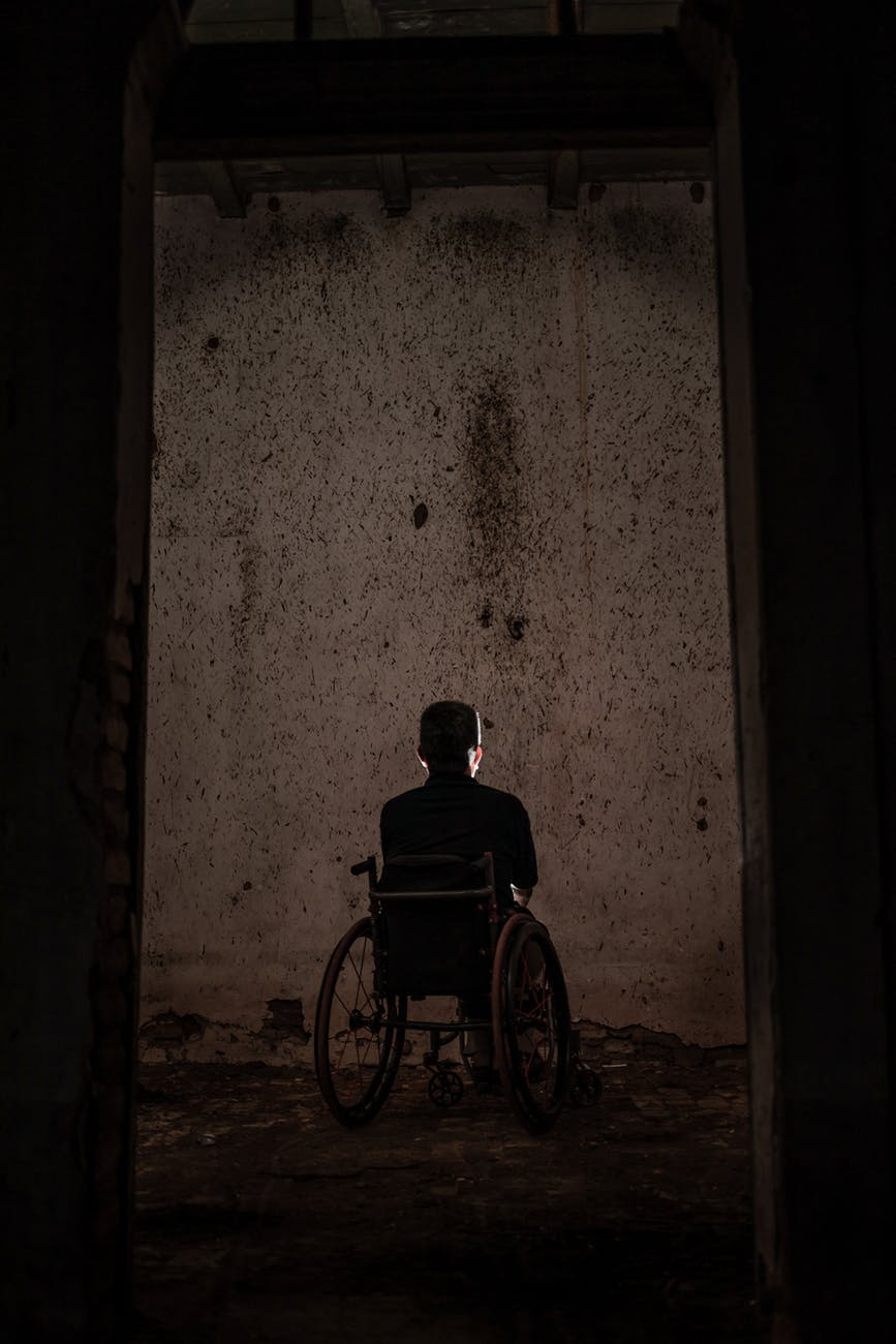 man sitting on a wheelchair