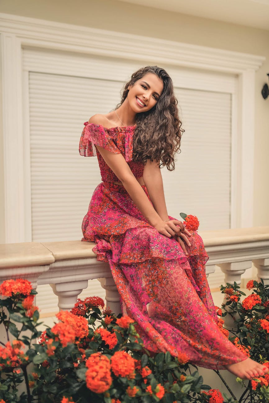 woman wearing long pink floral dress