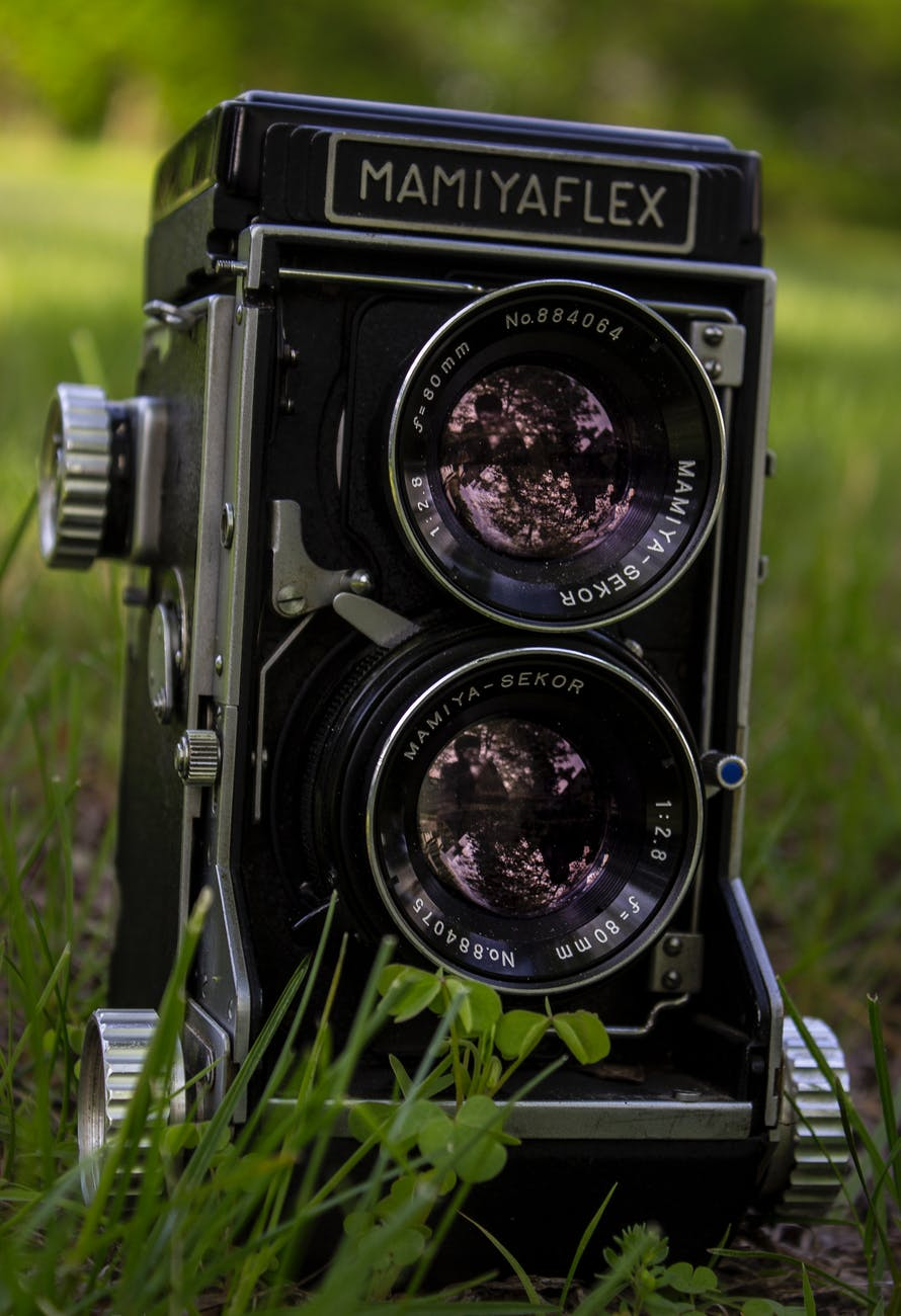 closeup of mamiya flex twin lens camera on grass