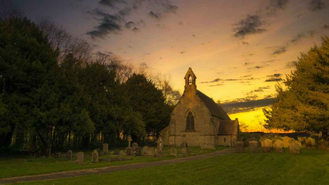 photo of brown concrete church during sunset