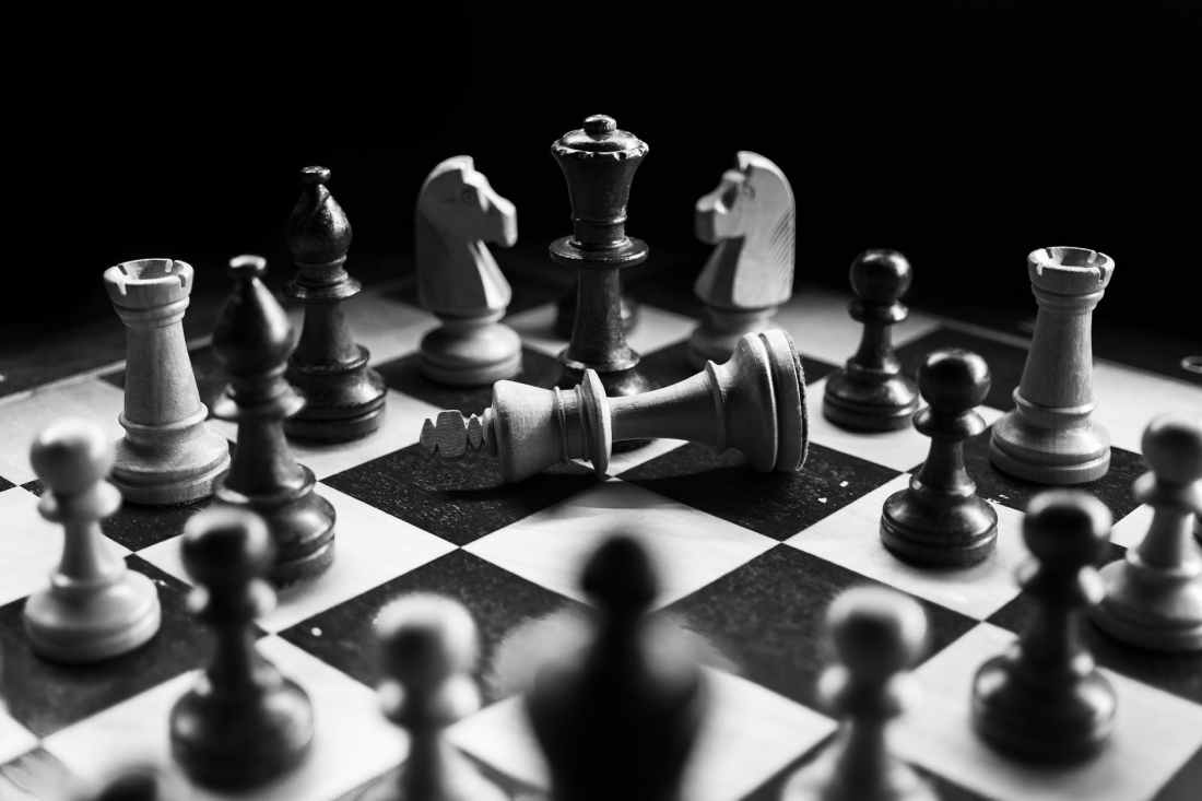 grayscale photography of chessboard game