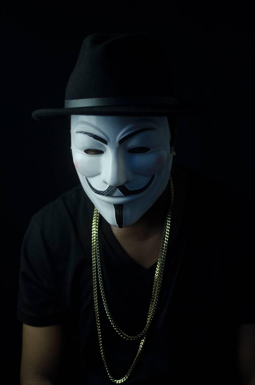 photo of man wearing guy fawkes mask